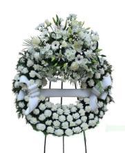 Corona funeraria un cabezal blanca