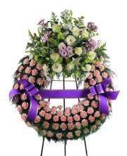 Corona funeraria un cabezal rosada